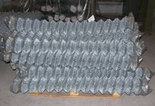 Rolls of chain-link fencing in compact packaging