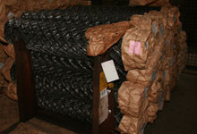 Rolls of chain-link fencing in common bulk packaging